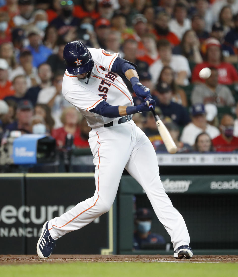 Houston Astros' Taylor Jones hits a sacrifice fly, allowing Carlos Correa to score a run, during the second inning of a baseball game against the Boston Red Sox, Monday, May 31, 2021, in Houston. (Karen Warren/Houston Chronicle via AP)