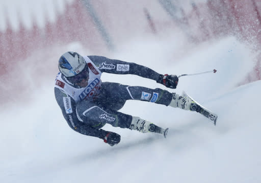 Norway's Aksel Lund Svindal speeds down the course during the men's downhill race, at the alpine ski World Championships in Are, Sweden, Saturday, Feb. 9, 2019. (AP Photo/Gabriele Facciotti)