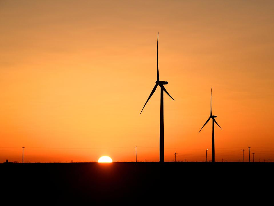 Wind turbines operate at sunrise in the Permian Basin oil and natural gas production area in Big Spring, Texas, 12 February, 2019. REUTERS/Nick Oxford (REUTERS)