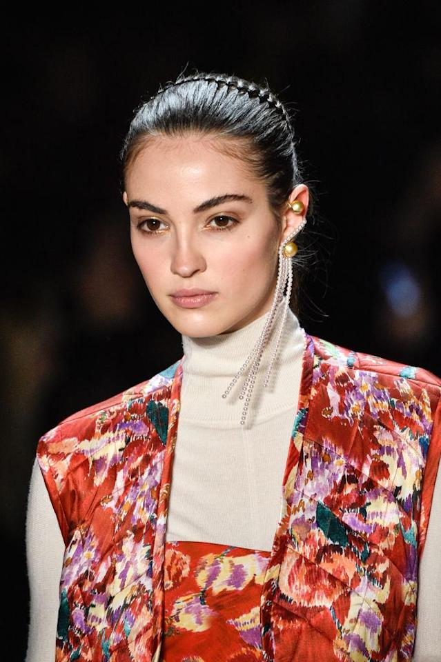 <p>Monocle gold and pearl strand earring at the Prabal Gurung FW18 show. (Photo: Getty) </p>