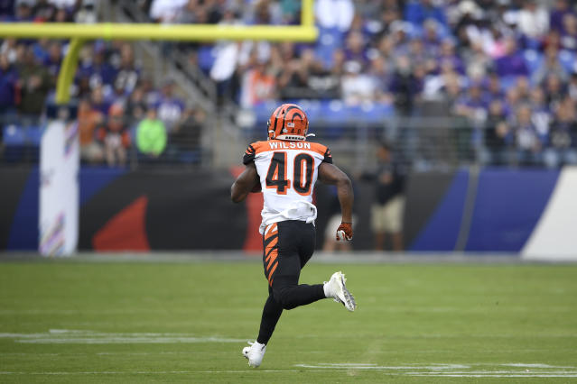 Cincinnati Bengals' Brandon Wilson runs uncontested while returning the opening kickoff from the Baltimore Ravens for a touchdown during the first half of an NFL football game Sunday, Oct. 13, 2019, in Baltimore. (AP Photo/Nick Wass)