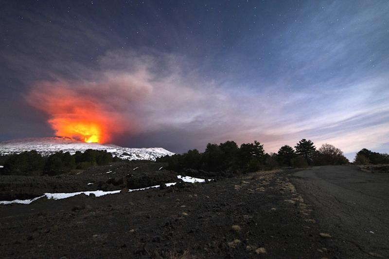 Mount Etna, Europe's most active volcano, is seen from the side of a road as it spews lava during an eruption in the early hours of Thursday, March 16, 2017. A new eruption which began on March 15 is causing no damages to Catania's airport which is fully operational. (AP Photo/Salvatore Allegra)