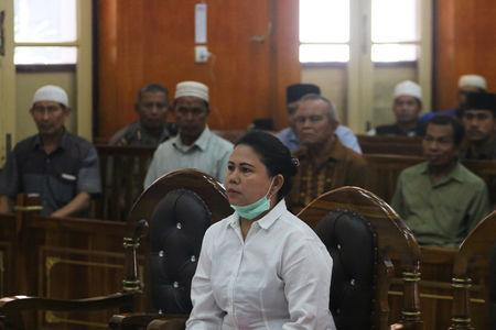 Meiliana, a 44-year-old ethnic Chinese Buddhist, sits in a courtroom for blasphemy charges, in Medan