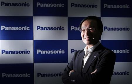 Panasonic Corp's President Kazuhiro Tsuga poses in front of company logos after an interview with Reuters in Tokyo September 4, 2013. REUTERS/Toru Hanai