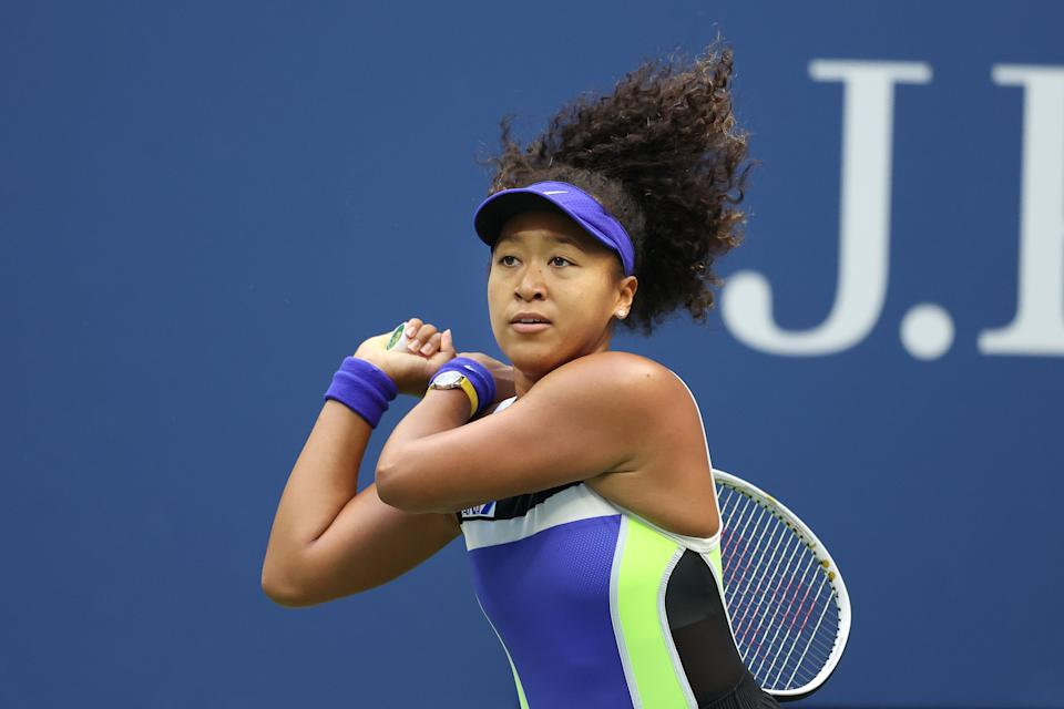 NEW YORK, NEW YORK - SEPTEMBER 12: Naomi Osaka of Japan returns the ball in the second set during her Women's Singles final match against Victoria Azarenka of Belarus on Day Thirteen of the 2020 US Open at the USTA Billie Jean King National Tennis Center on September 12, 2020 in the Queens borough of New York City. (Photo by Al Bello/Getty Images)