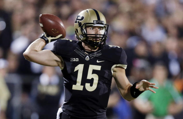 Purdue quarterback Rob Henry throws against Notre Dame during the first half of an NCAA college football game in West Lafayette, Ind., Saturday, Sept. 14, 2013. (AP Photo/Michael Conroy)