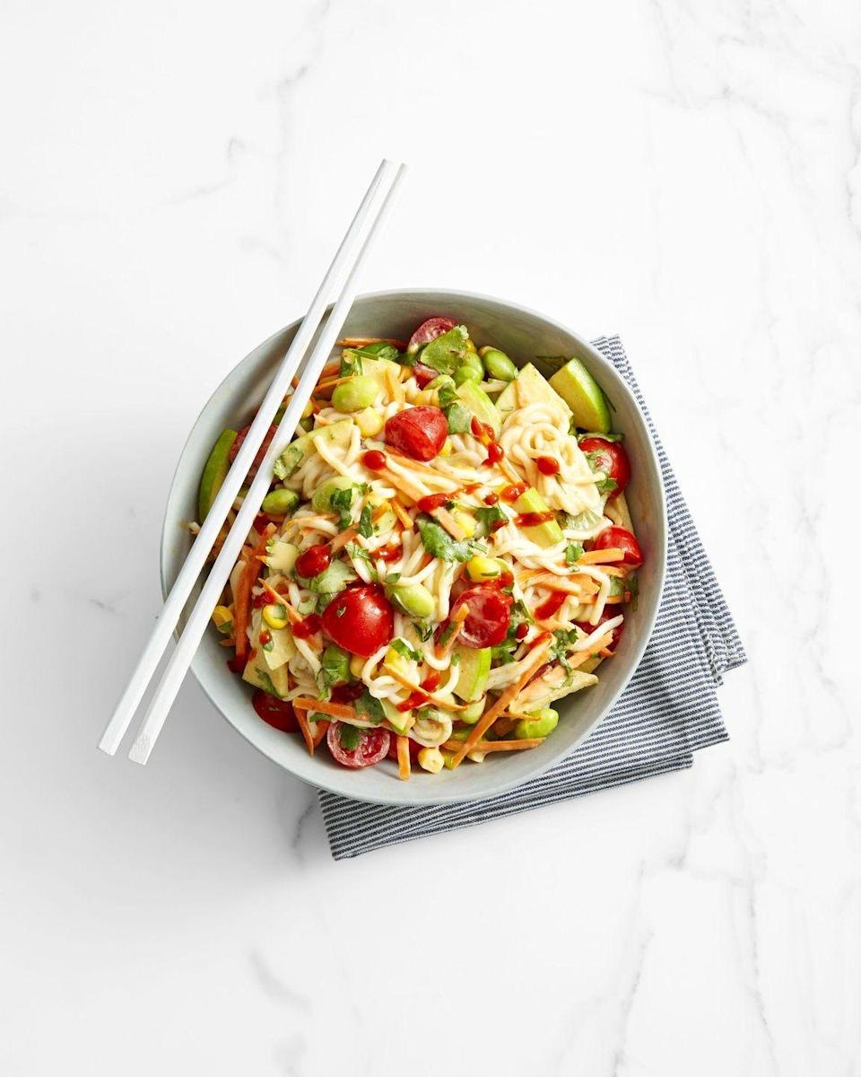 """<p>Shirataki noodles (gluten-free, yam-based noodles) keep this seriously flavorful stir-fry under 500 calories. Edamame, carrots, tomatoes, apple, and a fiery PB sauce make it so this salad fills you up.</p><p><em><a href=""""https://www.goodhousekeeping.com/food-recipes/healthy/a42200/peanutty-edamame-and-noodle-salad-recipe/"""" rel=""""nofollow noopener"""" target=""""_blank"""" data-ylk=""""slk:Get the recipe for Peanutty Edamame and Noodle Salad »"""" class=""""link rapid-noclick-resp"""">Get the recipe for Peanutty Edamame and Noodle Salad »</a></em></p>"""