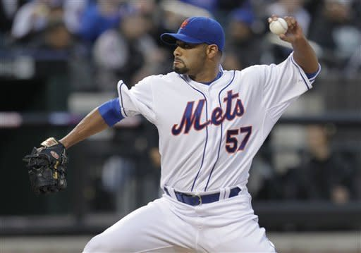 New York Mets pitcher Johan Santana throws during the first inning of a baseball game against the Miami Marlins on Tuesday, April 24, 2012, at Citi Field in New York. (AP Photo/Seth Wenig)