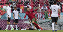 Portugal's Cristiano Ronaldo celebrates after scoring the opening goal during the Euro 2020 soccer championship group F match between Portugal and Germany in Munich, Saturday, June 19, 2021. (AP Photo/Matthias Schrader, Pool)