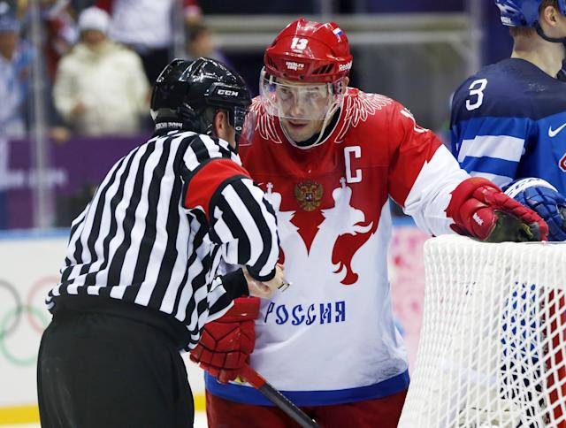 Russia forward Pavel Datsyuk appeals to an official in the third period of a men's quarterfinal ice hockey game against Finland at the 2014 Winter Olympics, Wednesday, Feb. 19, 2014, in Sochi, Russia. (AP Photo/Julio Cortez)