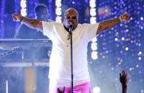 """FILE - This March 1, 2012 file photo shows Cee Lo Green performing at the Caesars Entertainment """"Escape To Total Rewards"""" concert in Los Angeles. The lyric video _ which features words onscreen while a song plays _ is not a new phenomenon in music. But these days, lyric videos are used to promote new songs, giving fans something to hold on to between a song's release and the launch of an official music video. When Green released the audio version of """"(Expletive) You"""" in 2010, he created a colorful, cartoonish video with the song's lyrics appearing onscreen as the song played. (AP Photo/Chris Pizzello, file)"""