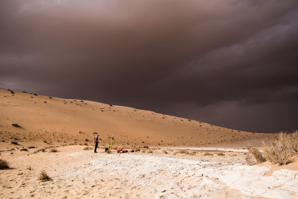 In this undated photo provided by the Palaeodeserts Project in September 2021, a storm arrives during an archaeological excavation of the remains of an ancient lake in northern Saudi Arabia, where ancient humans lived alongside animals such as hippos. (Klint Janulis/Palaeodeserts Project via AP)