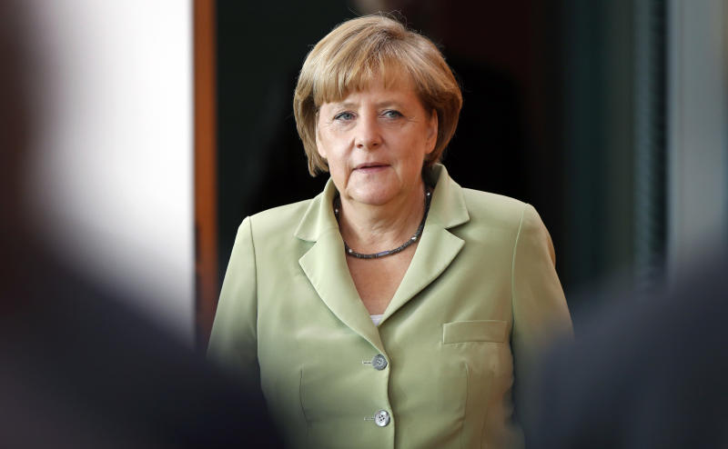 German Chancellor Angela Merkel arrives for the weekly cabinet meeting at the chancellery in Berlin, Germany, Wednesday, Aug. 21, 2013. (AP Photo/Michael Sohn)