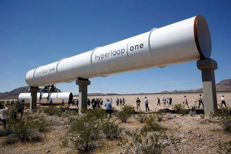 FILE PHOTO - Journalists and guests look over tubes following a propulsion open-air test at Hyperloop One in North Las Vegas, Nevada, U.S. May 11, 2016. REUTERS/Steve Marcus