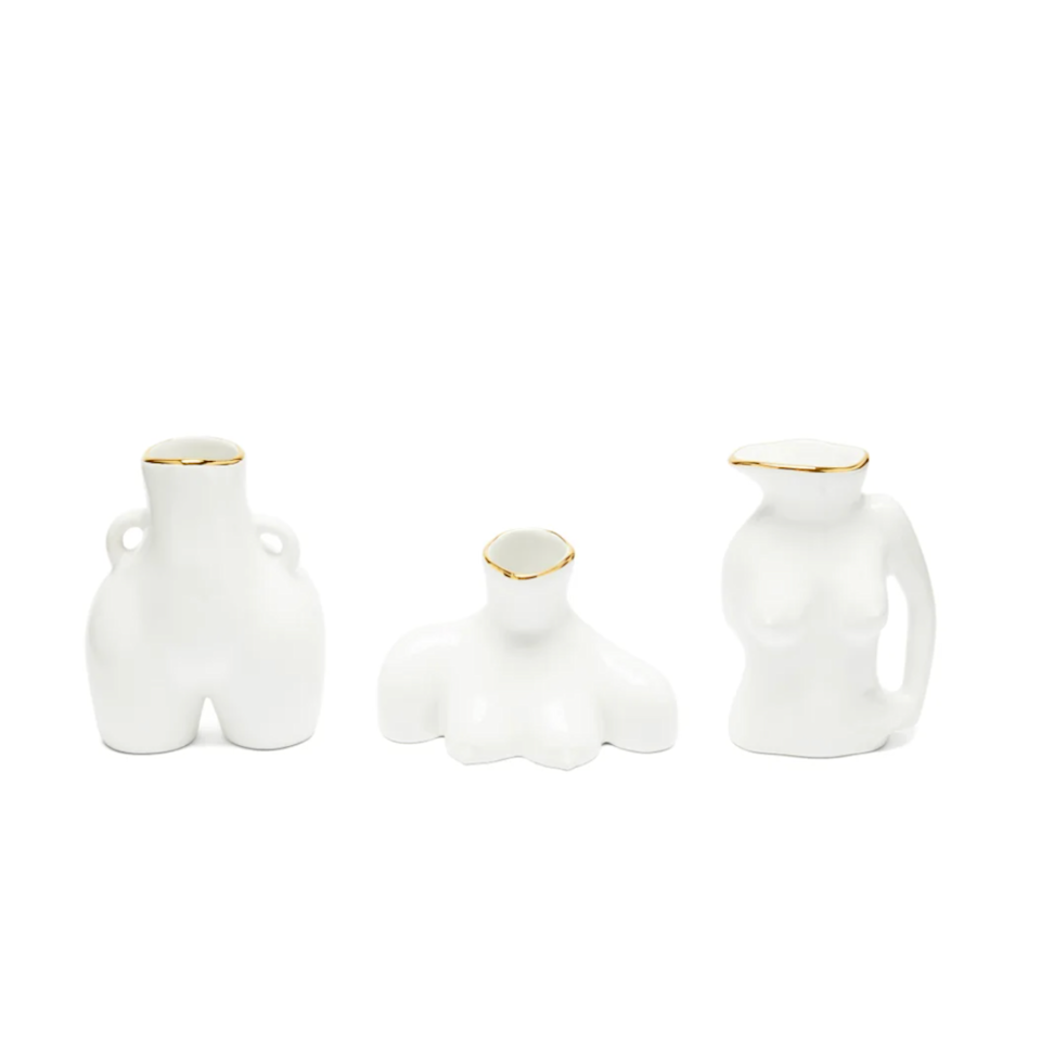"""Gift the home-decor enthusiast on your list this trio of Anissa Kermiche <a href=""""https://www.glamour.com/gallery/cool-vases?mbid=synd_yahoo_rss"""" rel=""""nofollow noopener"""" target=""""_blank"""" data-ylk=""""slk:ceramic vases"""" class=""""link rapid-noclick-resp"""">ceramic vases</a>. She can display the set together, or scatter the vessels around the house with sprigs of <a href=""""https://www.glamour.com/gallery/best-dried-flowers?mbid=synd_yahoo_rss"""" rel=""""nofollow noopener"""" target=""""_blank"""" data-ylk=""""slk:dried eucalyptus"""" class=""""link rapid-noclick-resp"""">dried eucalyptus</a>. $178, Matchesfashion. <a href=""""https://www.matchesfashion.com/us/products/Anissa-Kermiche-Set-of-three-mini-eartherware-vases-1437341"""" rel=""""nofollow noopener"""" target=""""_blank"""" data-ylk=""""slk:Get it now!"""" class=""""link rapid-noclick-resp"""">Get it now!</a>"""