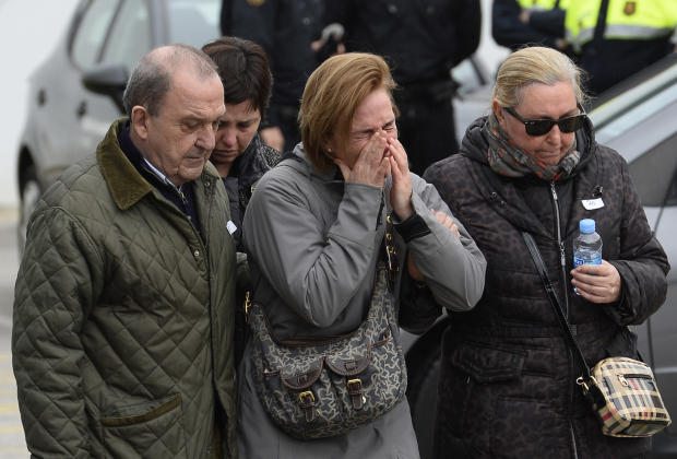 Crying people arrive at Barcelona airport in Spain, Tuesday, March 24, 2015. A Germanwings passenger jet carrying 150 people crashed Tuesday in the French Alps region as it traveled from Barcelona to Duesseldorf in Germany. (AP Photo/Manu Fernandez)