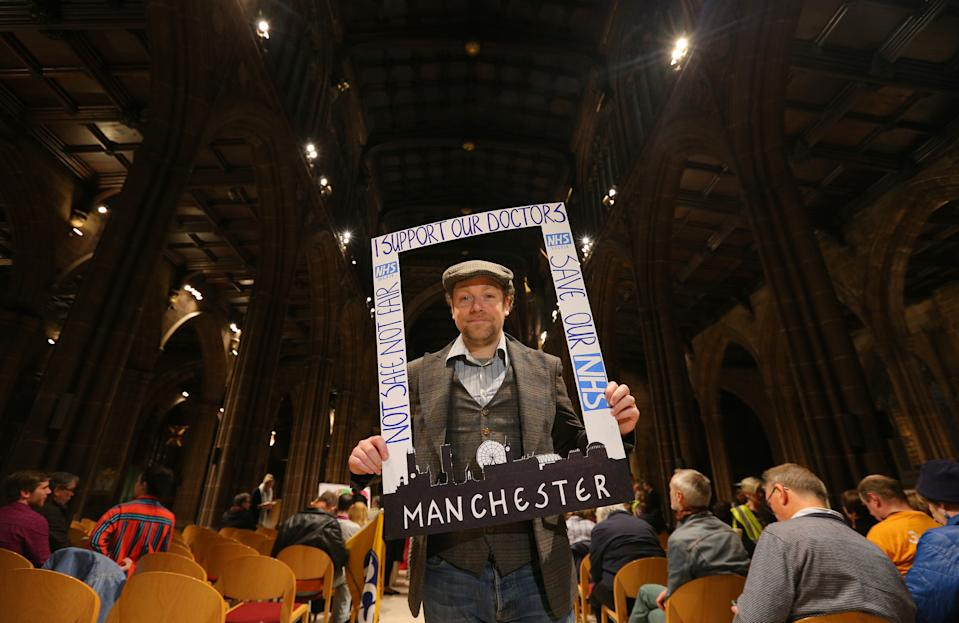 MANCHESTER, ENGLAND - NOVEMBER 11: Comedian Rufus Hound arrives to join members of the public and junior doctors during a rally at Manchester Cathedral on November 11, in Manchester, England. Protesters turned out to speak against the proposed new Junior Doctor Contract proposed by Health Secretary Jeremy Hunt. (Photo by Dave Thompson/Getty Images)