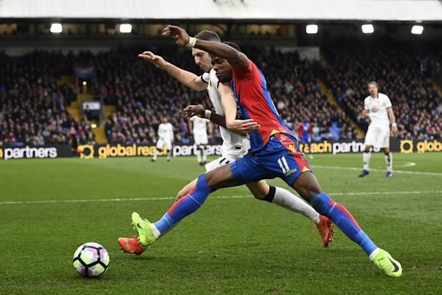 <p>Crystal Palace's Wilfried Zaha in action with Watford's Craig Cathcart </p>