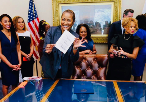 Senator Holly J. Mitchell celebrates Gov. Cavin Newsom signing the CROWN Act on July 3, 2019, making California the first state to pass the bill. (Photo: JOY Collective)
