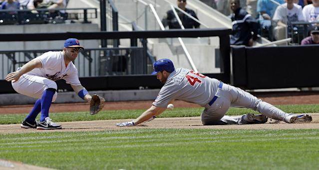 Chicago Cubs' Scott Feldman (46) slides in safely at third base as New York Mets third baseman David Wright (5) waits for the ball during the fourth inning of a baseball game Saturday, June 15, 2013, in New York. Feldman advanced from first base on a single by Darwin Barney. (AP Photo/Frank Franklin II)