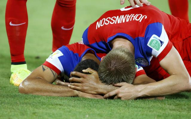 John Brooks of the U.S. (L) celebrates his goal against Ghana next to teammate Aron Johannsson during their 2014 World Cup Group G soccer match at the Dunas arena in Natal June 16, 2014. REUTERS/Stefano Rellandini (BRAZIL - Tags: SOCCER SPORT WORLD CUP)