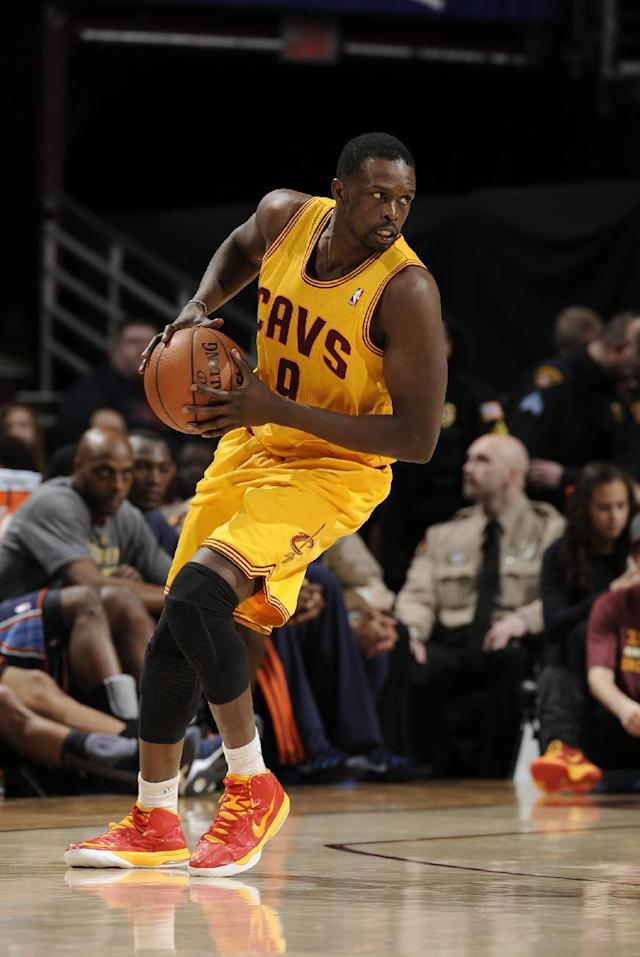 CLEVELAND, OH - APRIL 5: Luol Deng #9 of the Cleveland Cavaliers handles the ball against the Charlotte Bobcats at The Quicken Loans Arena on April 5, 2014 in Cleveland, Ohio. (Photo by David Liam Kyle/NBAE via Getty Images)