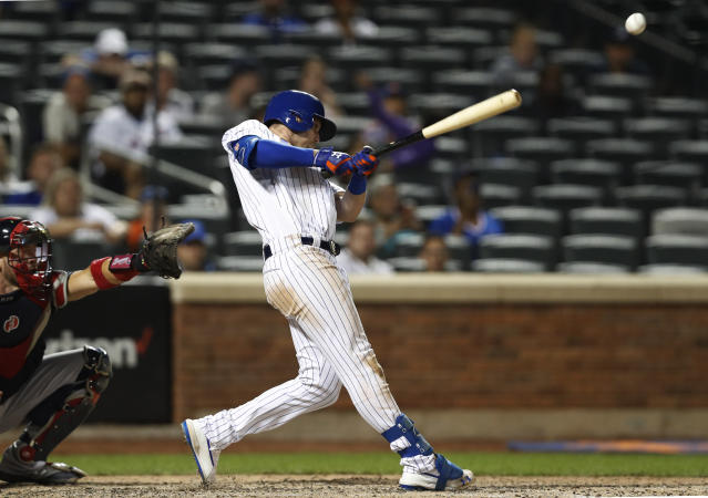 New York Mets' Jeff McNeil hits a go-ahead, two-run single during the eighth inning of a baseball game against the Atlanta Braves, Sunday, June 30, 2019, in New York. (AP Photo/Kathy Willens)