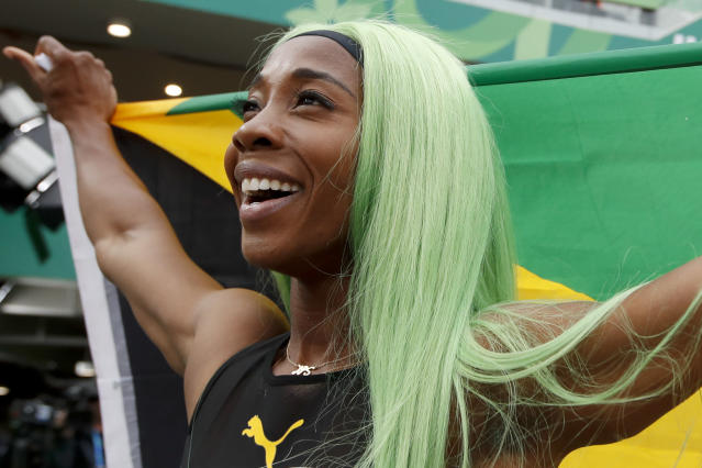 Shelly-Ann Fraser-Pryce ofJamaica celebrates winning the gold medal in the women's 200m final during the athletics at the Pan American Games in Lima, Peru, Friday, Aug. 9, 2019. (AP Photo/Moises Castillo)