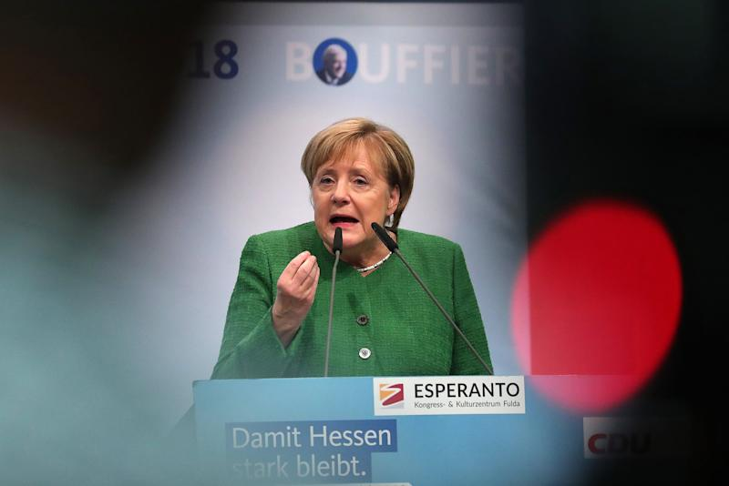 Merkel party suffers heavy losses in key regional election