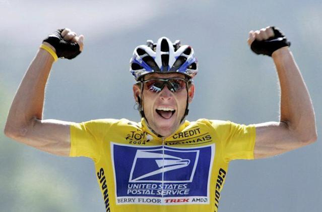 Armstrong raises his arms as he crosses the finish line to win the 17th stage of the 2004 Tour de France. (Wolfgang Rattay/Reuters/File)