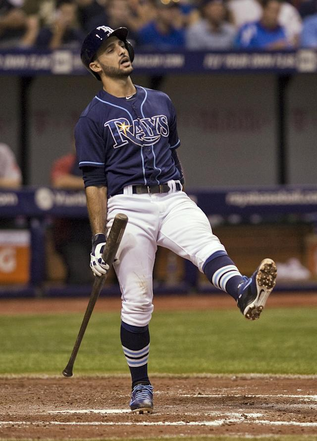 Tampa Bay Rays' Sean Rodriguez reacts to a called third strike by Boston Red Sox starter John Lackey during the fifth inning of a baseball game Friday, May 23, 2014, in St. Petersburg, Fla. (AP Photo/Steve Nesius)