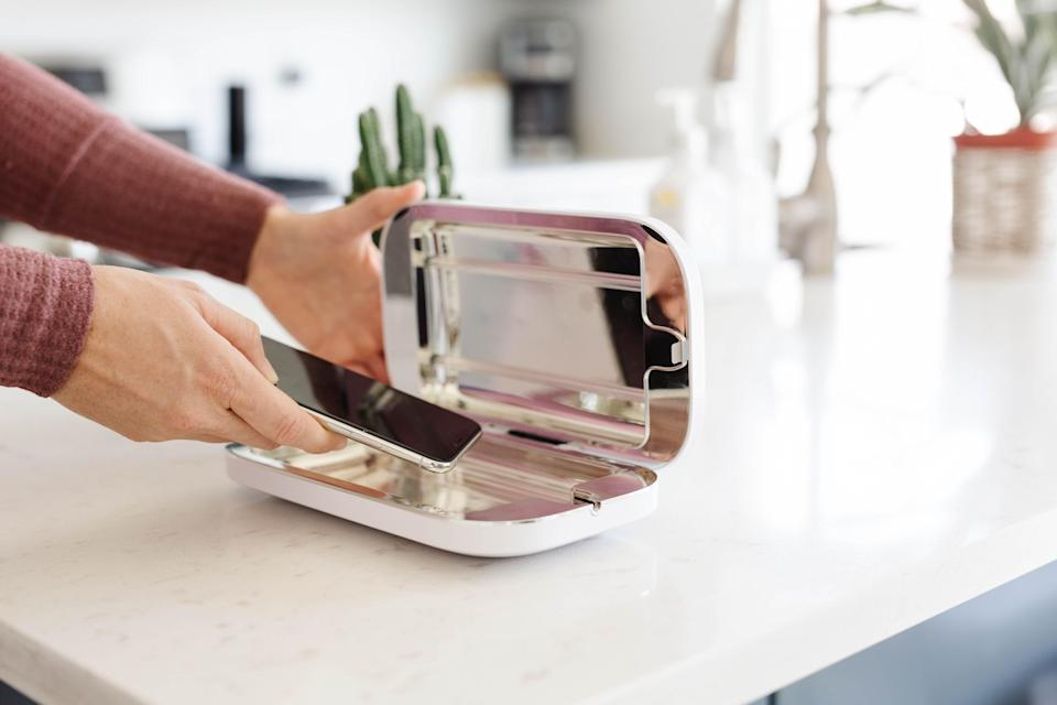 """<h3>PhoneSoap</h3><br><strong>Dates:</strong> Limited time <br><strong>Deal: </strong>Take 20% off your cart, no exceptions<br><strong>Promo Code: </strong>HOLIDAY20<br><br><em>Shop </em><strong><em><a href=""""https://www.phonesoap.com/"""" rel=""""nofollow noopener"""" target=""""_blank"""" data-ylk=""""slk:PhoneSoap"""" class=""""link rapid-noclick-resp"""">PhoneSoap</a></em></strong><br><br><br><strong>Phonesoap</strong> Smartphone UV Sanitizer, $, available at <a href=""""https://go.skimresources.com/?id=30283X879131&url=https%3A%2F%2Fwww.phonesoap.com%2Fproducts%2Fphonesoap-3-phone-uv-sanitizer"""" rel=""""nofollow noopener"""" target=""""_blank"""" data-ylk=""""slk:PhoneSoap"""" class=""""link rapid-noclick-resp"""">PhoneSoap</a>"""