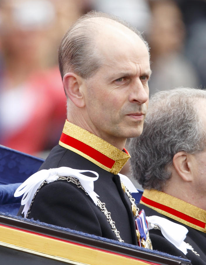 LONDON, UNITED KINGDOM - MAY 08: (EMBARGOED FOR PUBLICATION IN UK NEWSPAPERS UNTIL 48 HOURS AFTER CREATE DATE AND TIME) Paul Whybrew (L), Queen Elizabeth II's personal Page, in his role as Serjeant at Arms travels in a horse drawn carriage from Buckingham Palace to attend the State Opening of Parliament on May 8, 2013 in London, England. Queen Elizabeth II unveiled the coalition government's legislative programme in a speech delivered to Members of Parliament and Peers in The House of Lords. Proposed legislation is expected to be introduced on toughening immigration regulations, capping social care costs in England and setting a single state pension rate of 144 GBP per week. (Photo by Max Mumby/Indigo/Getty Images)