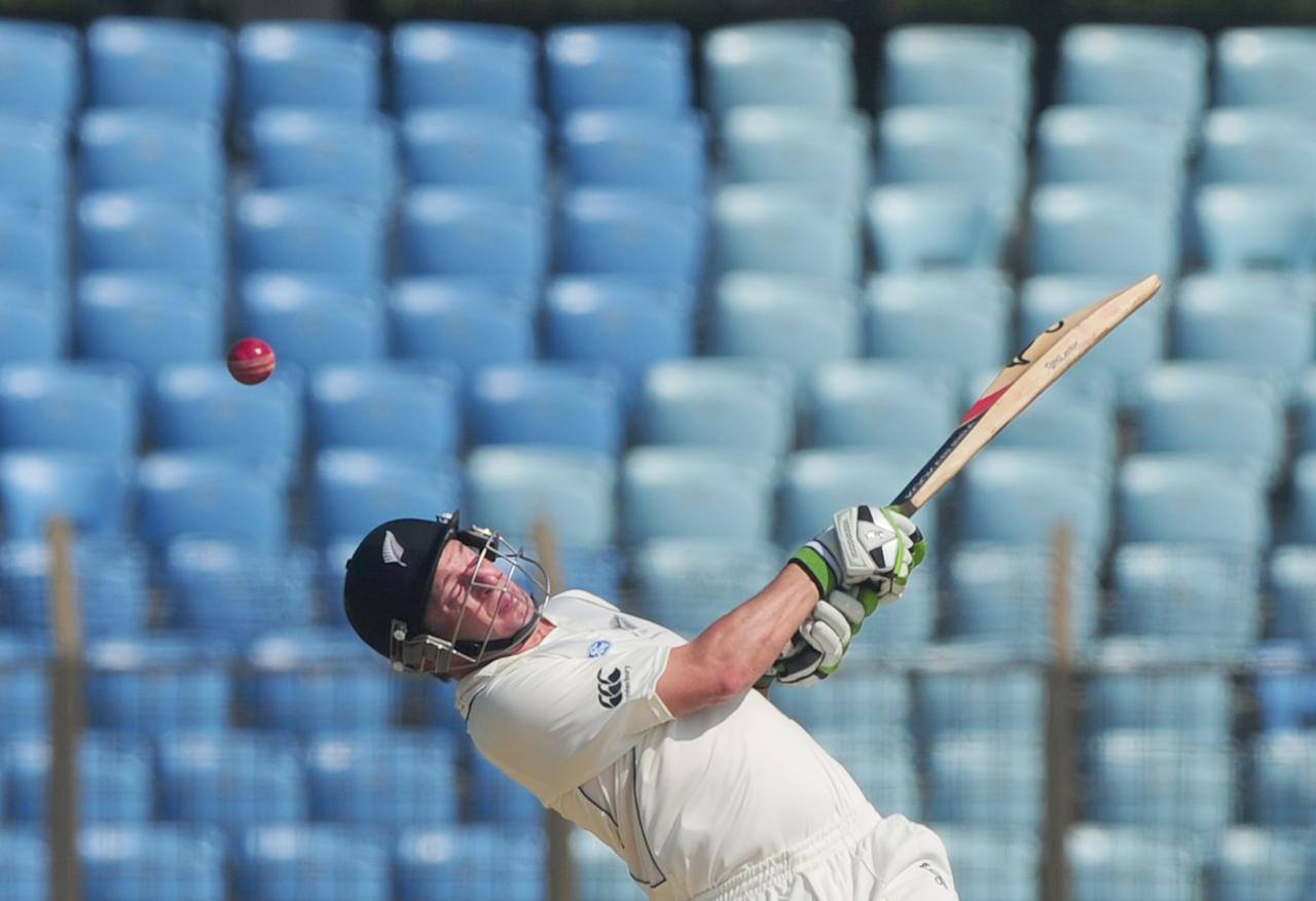 New Zealans cricketer Bruce Martin plays a shot during the second day of the first cricket Test match between Bangladesh and New Zealand at The Zahur Ahmed Chowdhury Stadium in Chittagong on October 10, 2013. AFP PHOTO/Munir uz ZAMAN        (Photo credit should read MUNIR UZ ZAMAN/AFP/Getty Images)