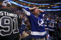 Tampa Bay Lightning fan Rob Bagby, of Winter Haven, reacts from Amalie Arena in Tampa, Fla., Monday, July 5, 2021, to watching Game 4 of the NHL hockey Stanley Cup final in Montreal, go into overtime against the Montreal Canadiens. (Ivy Ceballo/Tampa Bay Times via AP)