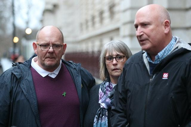 Tim Dunn with his wife Tracey and family spokesman Radd Seiger
