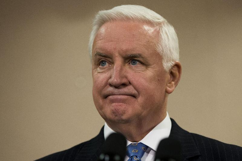 Gov. Tom Corbett listens to a question during a news conference Friday, Jan. 17, 2014, in Philadelphia. Gov. A nearly 2-year-old requirement that almost all of Pennsylvania's 8.2 million voters must show photo identification before casting a ballot was struck down Friday by a state judge, setting the stage for a courtroom showdown before the state's highest court. The law, one of the strictest in the nation, was approved by the Republican-controlled Legislature and signed by Corbett in March 2012 over the protests of every single Democratic lawmaker. (AP Photo/Matt Rourke)