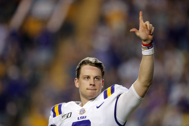 LSU quarterback Joe Burrow, who is considered a frontrunner for the Heisman Trophy, acknowledges the crowd as he is pulled from his last game in Tiger Stadium, in the fourth quarter of the team's NCAA college football matchup against Texas A&M in Baton Rouge, La., Saturday, Nov. 30, 2019. LSU won 50-7. (AP Photo/Gerald Herbert)