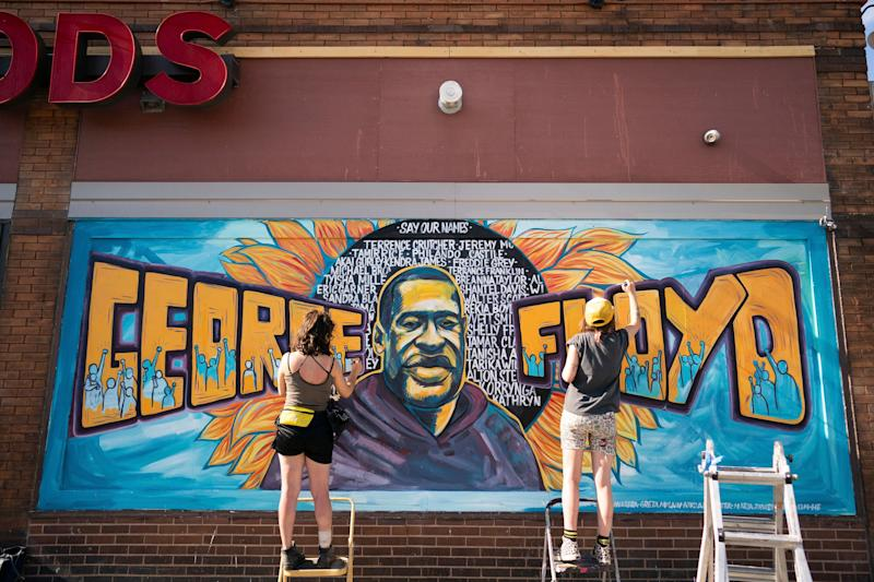 <strong>Artists complete a mural of George Floyd outside of Cup Foods in Minneapolis.</strong> (Photo: ASSOCIATED PRESS)