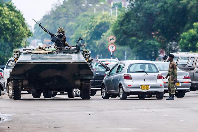 <p>An armoured personnel carrier stations by an intersection as Zimbabwean soldiers regulate traffic in Harare on Nov. 15, 2017. (Photo: AFP/Getty Images) </p>