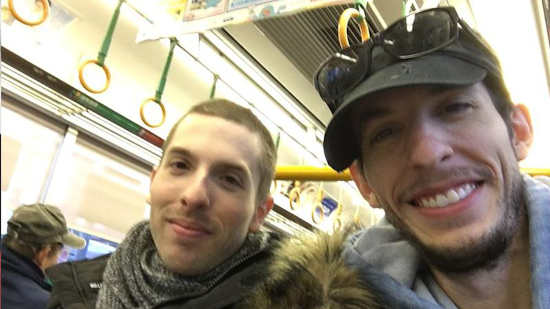 Grant Amato (right), poses with his brother Cody (left) during a trip to Japan in December