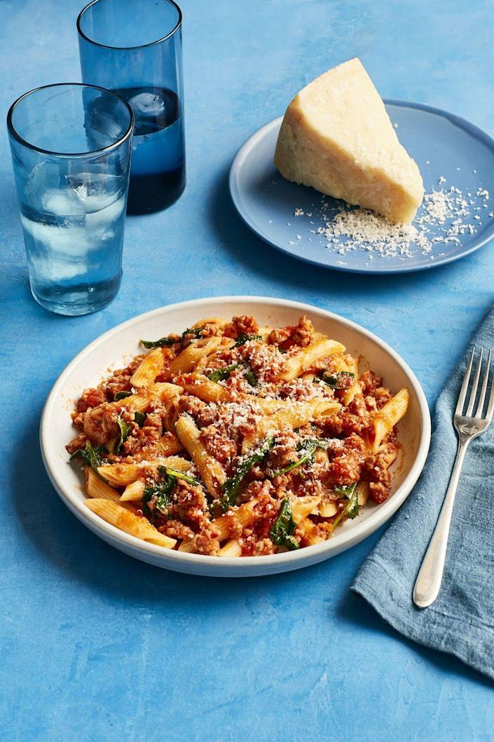 """<p>If you've had a hectic day of running around and need something hearty, this pasta dish will not disappoint. Sprinkle on some fresh parmesan, and you'll think you've been transported straight to Italy.</p><p><em><a href=""""https://www.womansday.com/food-recipes/food-drinks/recipes/a60509/pasta-with-easy-sausage-ragu-recipe/"""" rel=""""nofollow noopener"""" target=""""_blank"""" data-ylk=""""slk:Get the Pasta with Easy Sausage Ragu recipe."""" class=""""link rapid-noclick-resp"""">Get the Pasta with Easy Sausage Ragu recipe.</a></em></p>"""