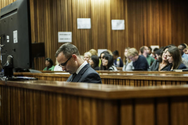 Oscar Pistorius in the dock in court in Pretoria, South Africa, Wednesday, May 14, 2014, as the judge overseeing his murder trial ordered him to undergo psychiatric tests. The court adjourned until May 21, 2014. (AP Photo/Gianluigi Guercia - Pool)