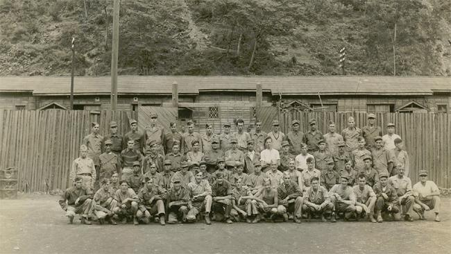 """<p class=""""MsoNormal"""" style=""""""""><span>Pictured here are the survivors from the Battle of Hong Kong who were held at Ohashi Prison Camp in Japan and liberated, after four years of captivity, on September 15, 1945. Photo courtesy of <a href=""""http://www.thememoryproject.com/stories/264:george-macdonell/"""" target=""""_blank"""">Historica-Dominion Institute</a>.</span></p>"""