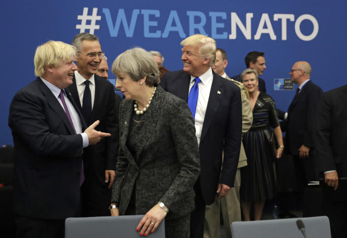 FILE - In this Thursday, May 25, 2017 file photo U.S. President Donald Trump jokes with British Foreign Minister Boris Johnson as British Prime Minister Theresa May walks past during a working dinner meeting at the NATO headquarters during a NATO summit of heads of state and government in Brussels. (AP Photo/Matt Dunham, Pool, File)