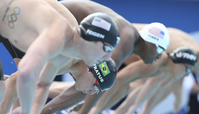 Starters including Bruno Fratus of Brazil bottom black cap, are set to dive in during their men's 50m freestyle heat at the Pan Pacific swimming championships in Gold Coast, Australia, Sunday, Aug. 24, 2014. (AP Photo/Rick Rycroft)