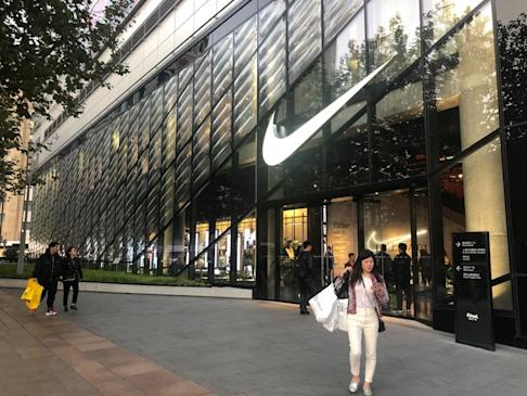 Customers are playing training session games at Nike's new flagship store on Nanjing East Road, one of Shanghai's most robust shopping districts. Photo: Pearl Liu