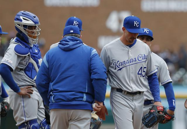 Kansas City Royals relief pitcher Kyle Zimmer (45) is relieved during the seventh inning of a baseball game against the Detroit Tigers, Thursday, April 4, 2019, in Detroit. (AP Photo/Carlos Osorio)