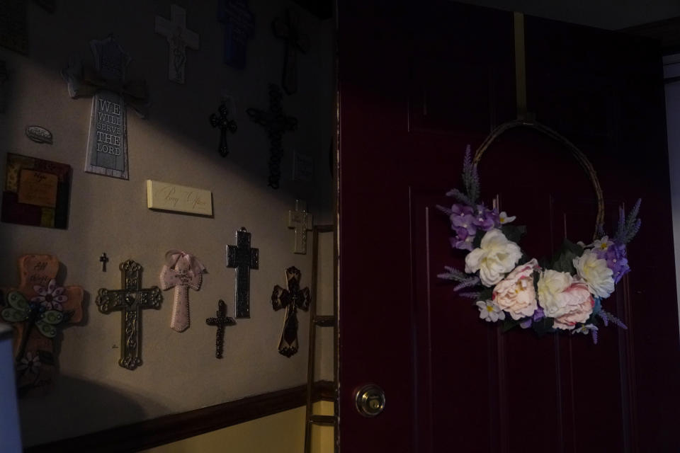 Crosses line a wall in Michelle Branch's home in St. Louis on Monday May 17, 2021. Her 56-year-old brother, Craig Elazer, died of a fentanyl overdose. (AP Photo/Brynn Anderson)
