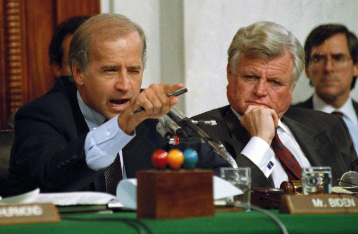 FILE - In this Oct. 12, 1991, file photo, then-Senate Judiciary Committee Chairman Sen. Joe Biden, D-Del., points angrily at Clarence Thomas during comments at the end of hearings on Thomas' nomination to the Supreme Court on Capitol Hill. Sen. Edward Kennedy, D-Mass., watches at right. (AP Photo/Greg Gibson, File)